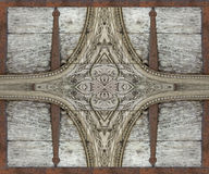 Wood and Iron Ornament Artwork. Photo manipulation collage digital background created with wood and iron in gray and red tones royalty free stock images