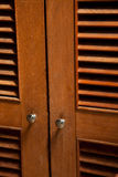 Wood jalousie door Stock Photos