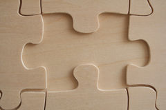 Wood jigsaw element. Wood jigsaw empty space close-up stock images
