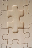 Wood jigsaw piece. Detail of a wooden jigsaw piece close-up royalty free illustration