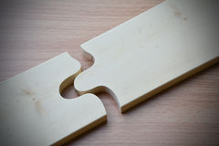 Wood jigsaw piece texture pattern on wood table desk wooden back Stock Photo