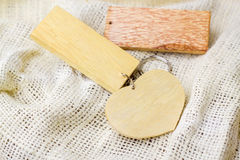 Wood key chain on white fabric Stock Photo