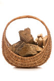Wood and kindling in a basket Stock Images