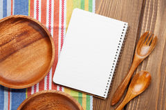 Wood kitchen utensils with notepad for copy space Stock Images