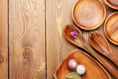 Wood kitchen utensils over wooden table Royalty Free Stock Photo
