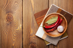 Wood kitchen utensils and spices over wooden table Stock Photos