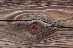 Wood Knot and Grain. Close up of an old, weather seasoned, cut piece of wood showing well developed grain and a knot Royalty Free Stock Image