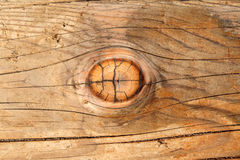 A wood knot in a wooden beam. Stock Photos