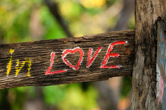 Wood label 'in love' Royalty Free Stock Images