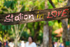 Wood label 'station in love' Royalty Free Stock Photo