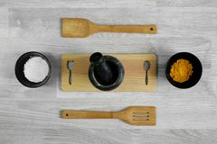 Wood ladle, mortar and spices on wood table background. Kitchen utensils Royalty Free Stock Photo