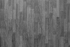 Laminate flooring background in black and white. Wood laminate flooring texture background in house in black and white Stock Photography