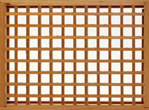 Wood Lattice Frame. Wooden lattice crisscross square pattern; white background royalty free stock image