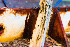 Wood leaning on rusty metal. A view of a piece of old, gnarled wood leaning against a piece of rusted metal Royalty Free Stock Photography