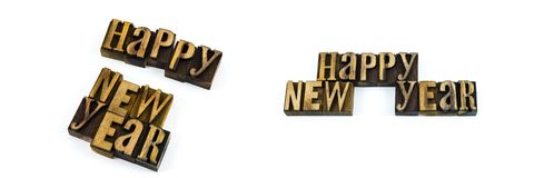 Happy new year type letterpress message. Wood letters holiday happy new year isolated letterpress blocks words celebration greeting stock photo