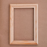 Wood light brown frame on a old paper Royalty Free Stock Image