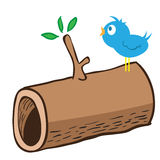 Wood log and a bird on it Royalty Free Stock Photos