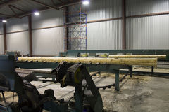 Wood Log Moving to Cutting Machine in Sawmill Stock Photography