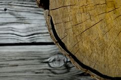 Wood log and plank. An abstract look at a wood log and a deck planks. From the origin to the resulting product royalty free stock image