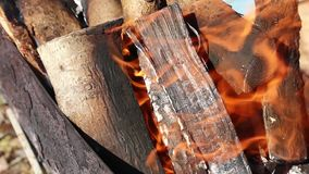 Wood logs are burning in the grill, fire envelops the tree in the grill, flame, fire stock footage
