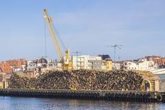 Wood logs and crane in port of Kolobrzeg, Poland Royalty Free Stock Image