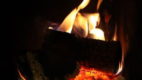 Wood logs fire burn in fireplace, romantic atmosphere. Wood logs fire burn in fireplace creating romantic atmosphere stock footage