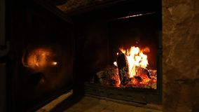 Wood logs fire burn in fireplace, romantic atmosphere stock video footage