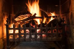 Wood Logs Fire Burning in a Traditional Country Fireplace. Wood Fire Burning in a Traditional Country Fireplace Royalty Free Stock Photos