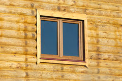 Wood logs house wall with window Stock Images