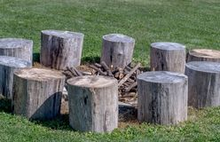 Wood logs set up as seats, around a pile of dry sticks stock images