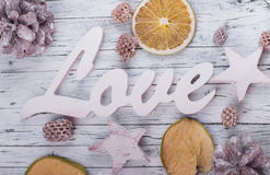 Wood love sign. And dried fruit Stock Photography