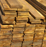 Wood Lumber Planks for Construction. Wood lumber, a renewable green resource, freshly cut in a pile waiting for use in construction royalty free stock photography