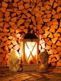 Wood lykta framme av en vedtrave Fotografering för Bildbyråer