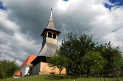 Wood made bell tower. Beautiful wood made bell tower form the small sekler village Paltinis/Kecset Romanian Stock Photography