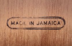 Wood Made in Jamaica dark. A piece of wood with a burnt engraving with the words Made in Jamaica Royalty Free Stock Image