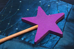 Wood made magic wand. Close shot of a magic wand with a pink star Royalty Free Stock Photography