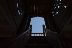 Wood-made stairs to another sky, light at the tunnel concept royalty free stock photo