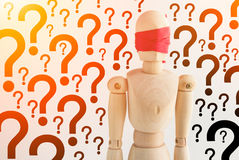 Wood man figure blind with red ribbon with question mark backgro Royalty Free Stock Photography