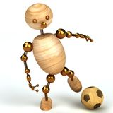 Wood man with a football Stock Photography