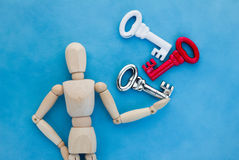 Wood man handle three keys.jpg Stock Photography