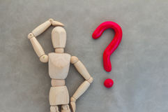 Wood man with question mark.jpg Stock Image