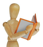 Wood man reading Royalty Free Stock Photo