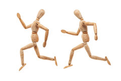 Wood man with running away pose Stock Photos