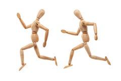 Wood man with running away pose Stock Photos
