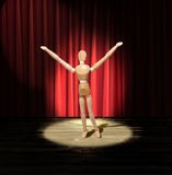 Wood man on stage. Wooden man performing on a stage royalty free stock photography