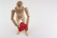 Wood Manikin and Candy Heart Royalty Free Stock Photos