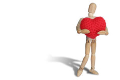 Wood manikin hug red heart knittingt  on white backgroun Royalty Free Stock Photos