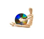 Wood mannequin with CD-rom royalty free stock photography