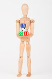 Wood mannequin holding colorful block dice Stock Image