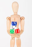 Wood mannequin holding colourful block dice Royalty Free Stock Photo